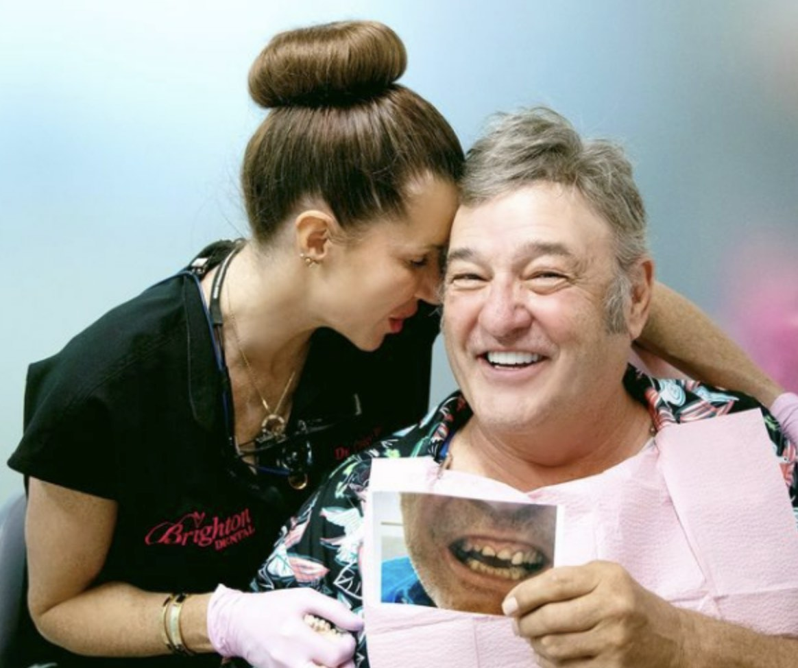 Photo of a happy patient after having Restorative Dentistry